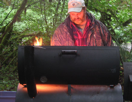 Jim gets the pit ready while Joe preps the steaks. The men of the tribe have been waiting a year for this.